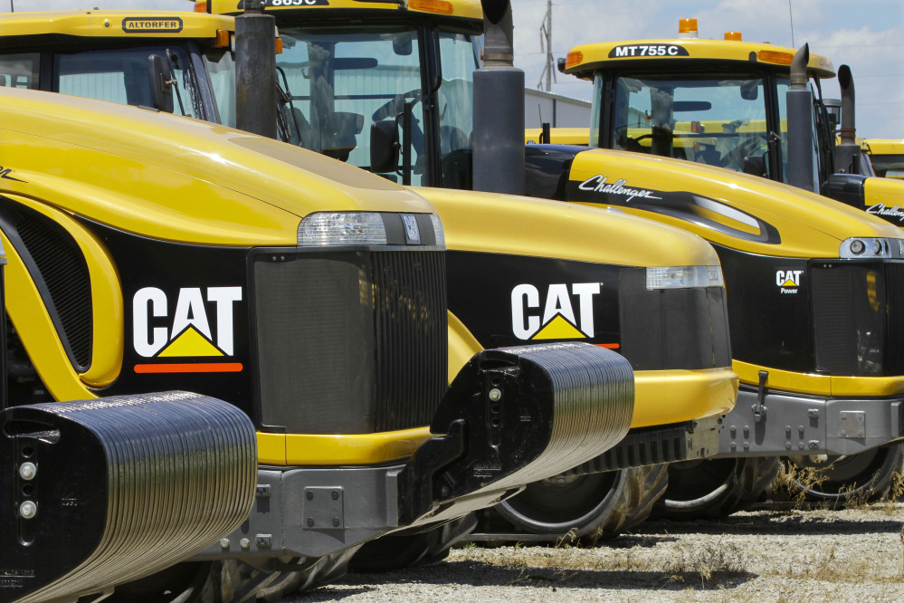 In this June 20, 2012 file photo, earth-moving tractors and equipment made by Peoria, Ill.-based Caterpillar Inc. are seen in Clinton, Ill. The Associated Press