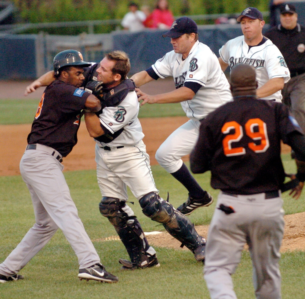 Bluefish catcher John Nathans fights with Long Island Ducks' Jose Offerman during a 2007 game in Bridgeport, Conn. Nathans said he distinctly remembers feeling Offerman's bat cracking into the back of his head.