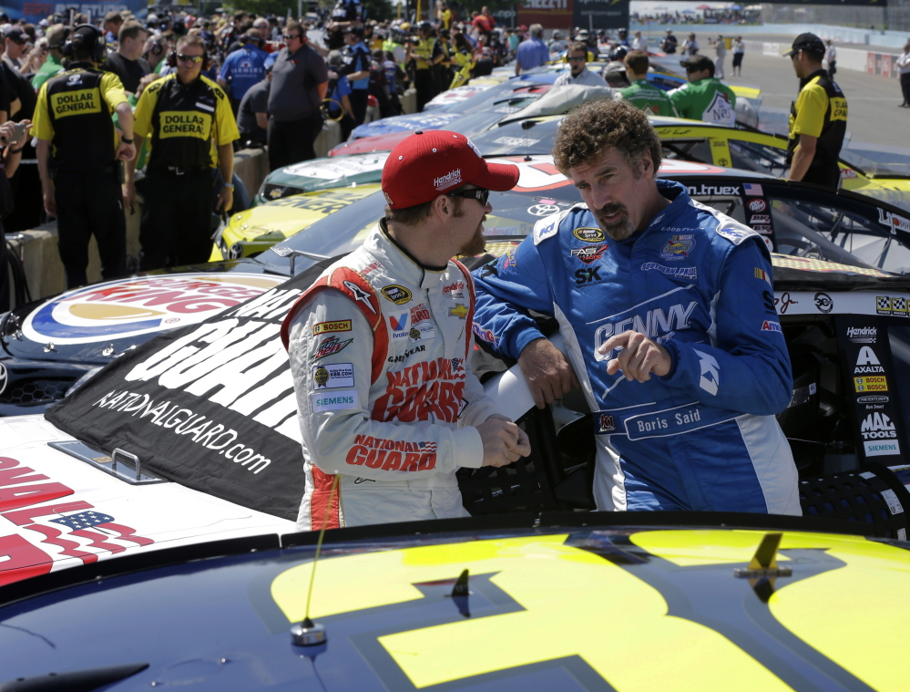 Dale Earnhardt Jr., left, and Boris Said talk on pit row Saturday before a qualifying session for Sunday's NASCAR Sprint Cup Series race at Watkins Glen International in Watkins Glen, N.Y. Earnhardt finished seventh in qualifying.