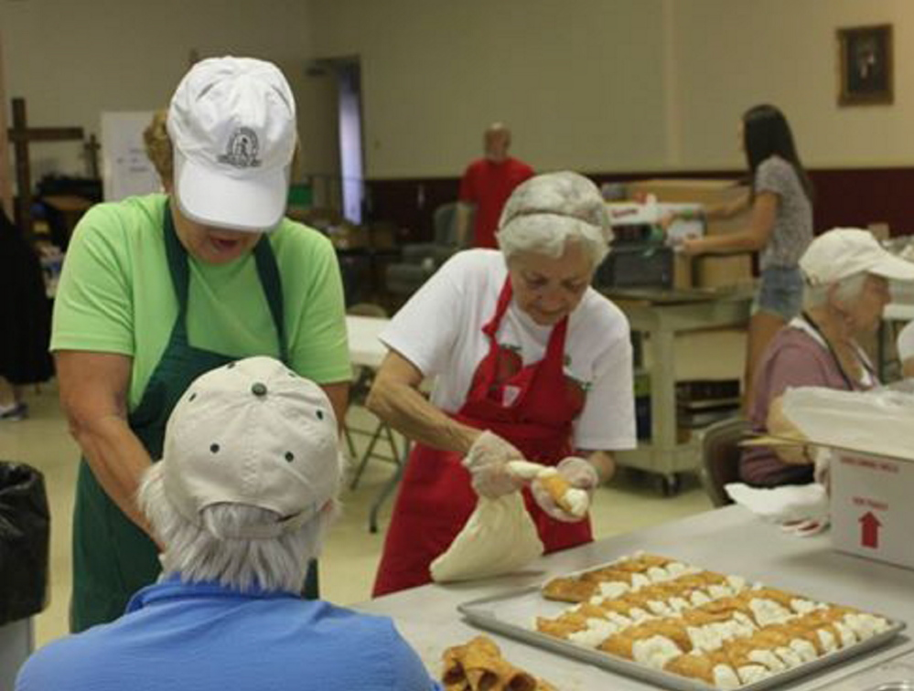 Members of the St. Peter's Italian Bazaar baking crew fill cannoli shells in advance of the 2013 festival. This year's event will be held Saturday and Sunday, featuring live music, family games and a wide array of treats.