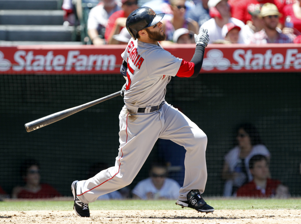 Red Sox second baseman Dustin Pedroia hits a double in the fourth inning against the Los Angeles Angels on Sunday in Anaheim, Calif.