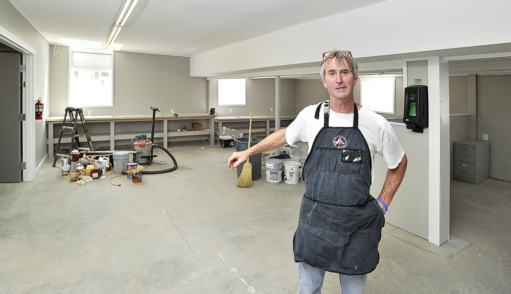 Community Bicycle Center Executive Director Andy Greif stands in  the space that now houses the nonprofit program in Biddeford in this Aug. 11, 2014, photo. The program now has four employees, dozens of volunteers and 400 participants each year.