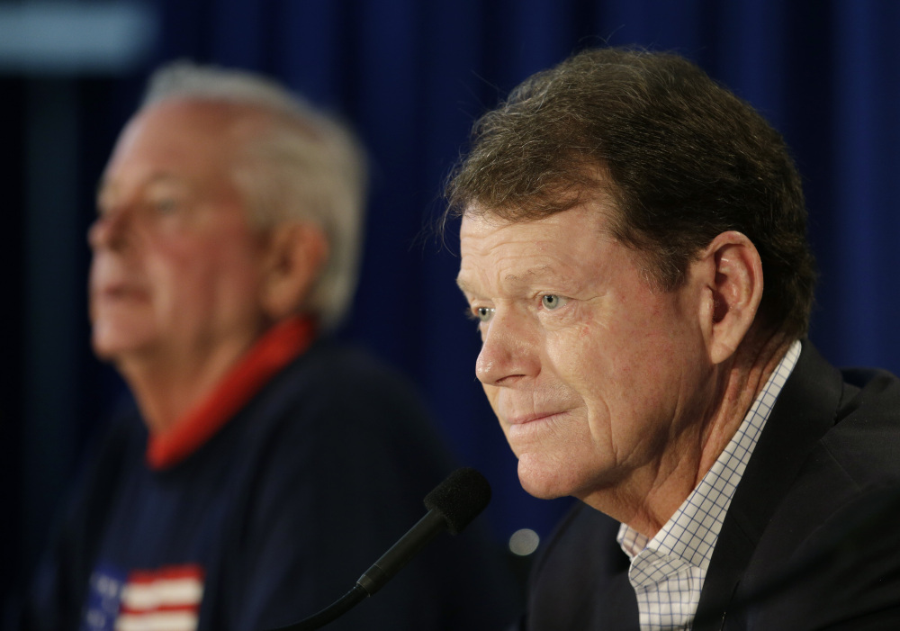 United States Ryder Cup Captain Tom Watson, right, speaks at a news conference at Valhalla Golf Club Monday, in Louisville, Ky.