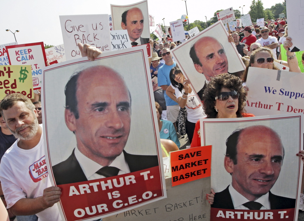 Market Basket employees and supporters hold a rally last month in Tewksbury, Mass., to back ousted former CEO Arthur T. Demoulas.