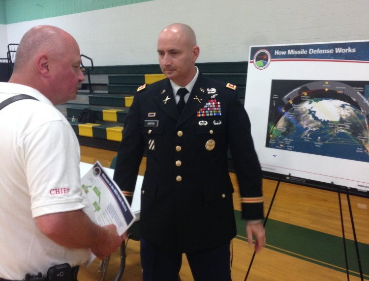 Rangeley Fire Chief Tim Pellerin, left, speaks with Lt. Col. Dan Martin at a public meeting on the potential environmental effect of a missile interceptor facility in Redington Township.