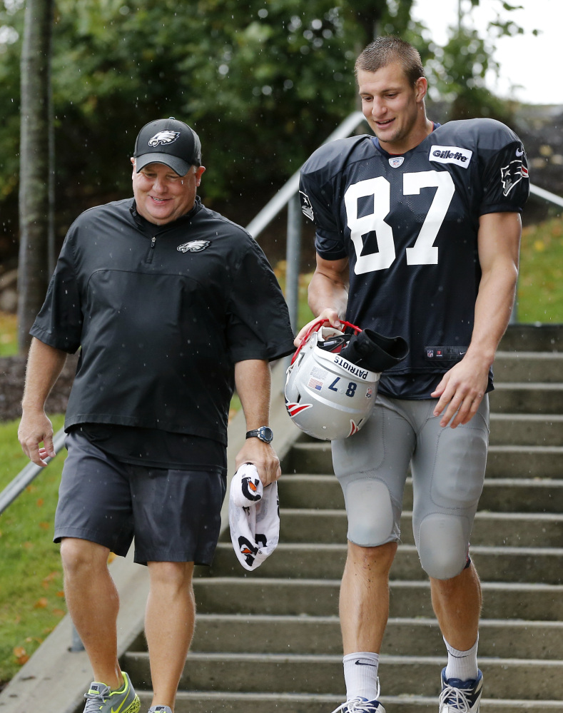 Philadelphia Eagles Coach Chip Kelly, whose mother was raised in Maine and whose parents live in Saco, leaves a joint practice Wednesday with tight end Rob Gronkowski of the New England Patriots.