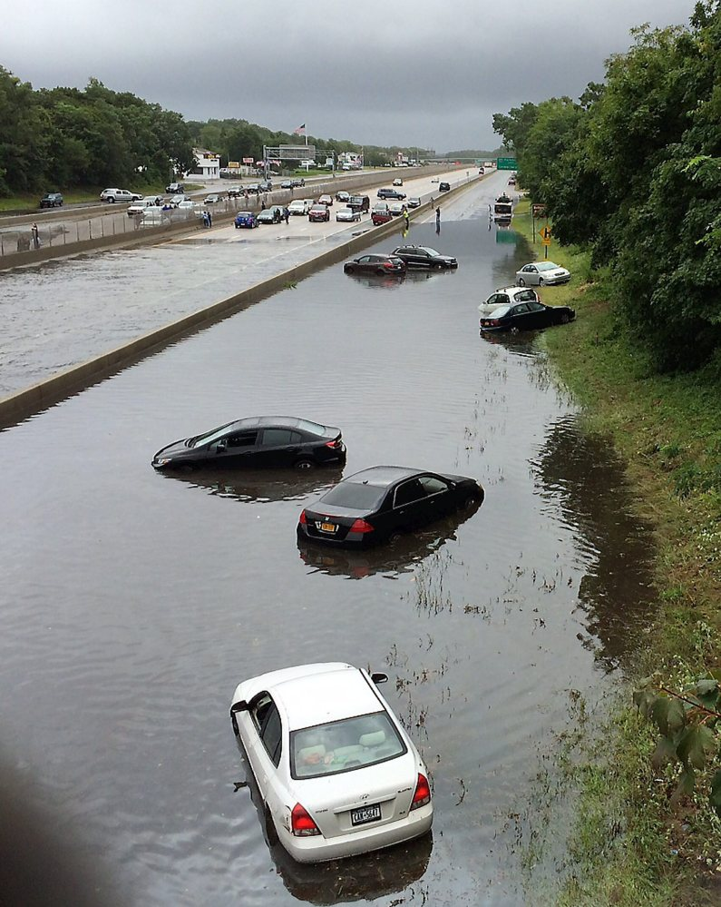 Vehicles are submerged Wednesday on a flooded section of Sunrise Highway in East Islip on New York's Long Island, where an entire summer's worth of rain fell in a matter of hours. One death was reported, in a weather-related crash on the Long Island Expressway.