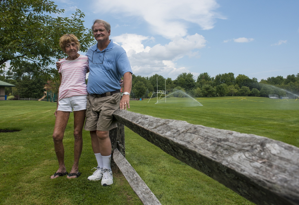 Wayne and Karen Tanguay, shown at Willey Field in Scarborough last week, are among Scarborough residents who believe the presence of cell towers would drive property values down.