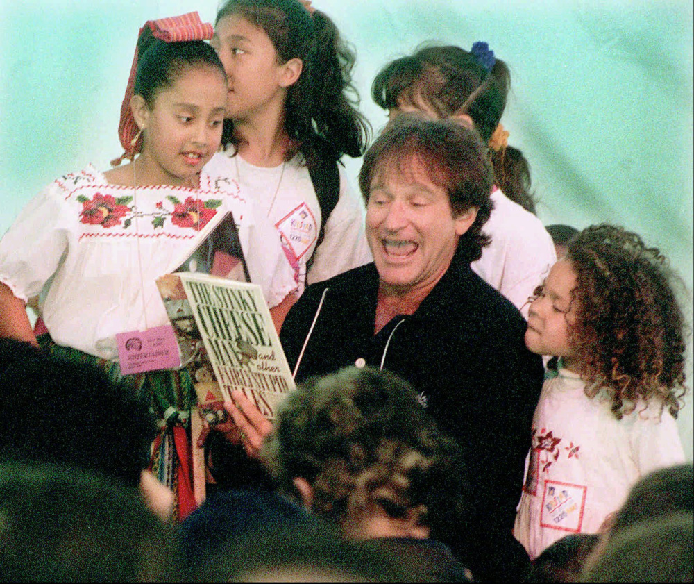 Robin Williams reads to children to help inaugurate the main library in San Francisco in 1996. From jogging to visiting hospitals, he made himself a part of the fabric of life there.