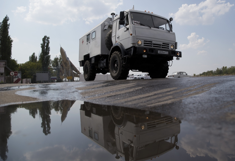 A truck moves out from the military base not far from Voronezh, Russia, on Wednesday. Russia dispatched some hundreds of trucks covered in white tarps and sprinkled with holy water on a mission to deliver aid to a rebel-held zone in eastern Ukraine.