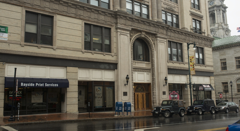 The front half of the Masonic Temple on Congress Street in Portland, with nearly 50,000 square feet of commercial office and retail space, will be auctioned off in September. The back half of the building is not for sale.