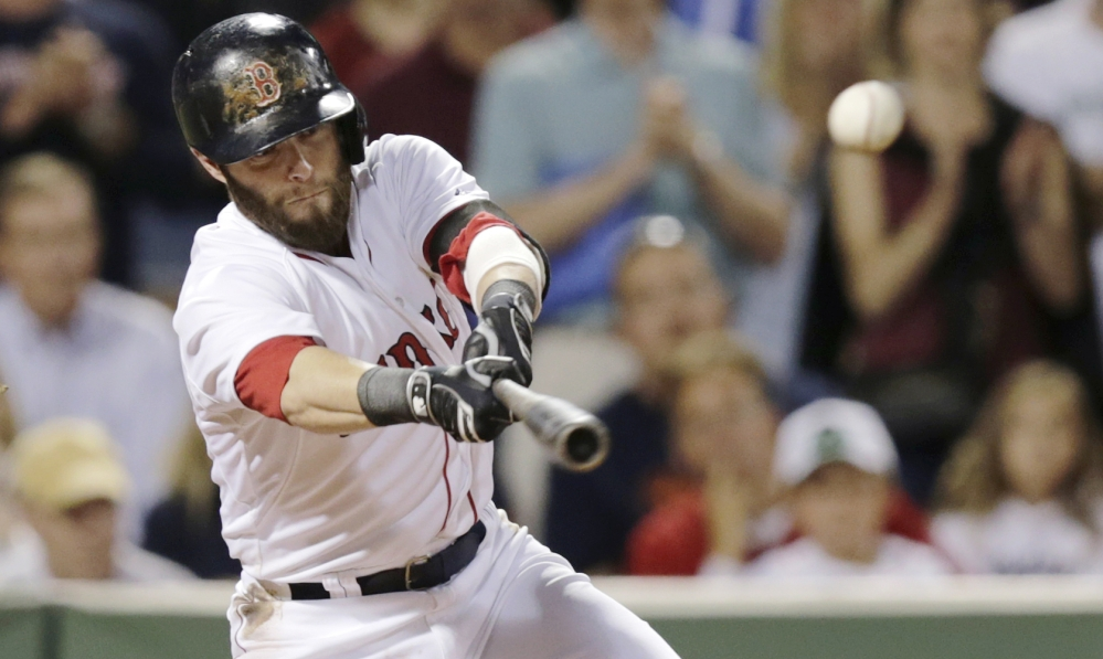 Red Sox second baseman Dustin Pedroia connects for an RBI double, which scored Will Middlebrooks, in the sixth inning against the Houston Astros at Fenway Park on Thursday. The Associated Press