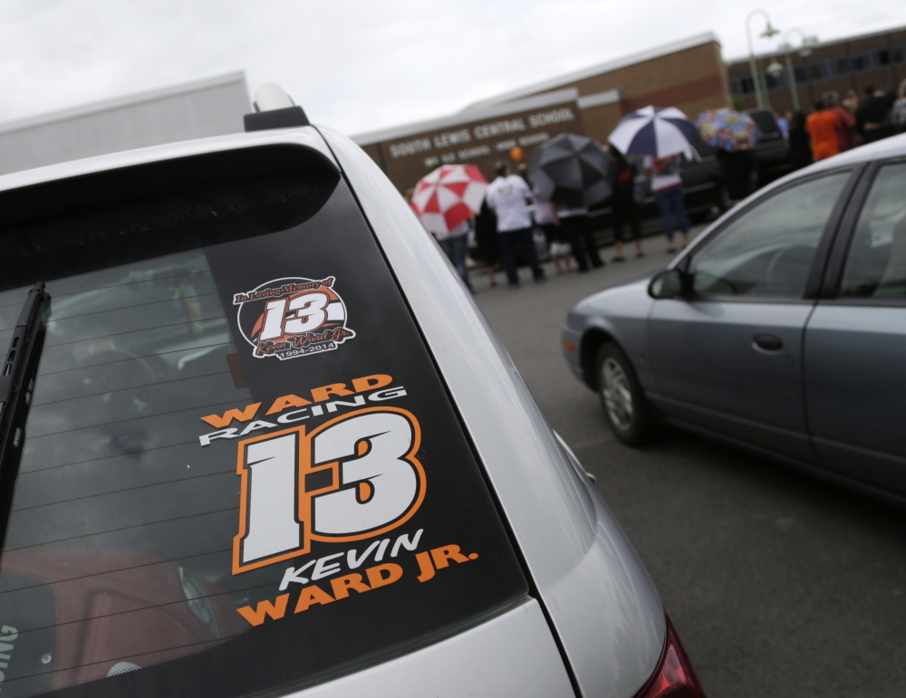 A Kevin Ward Jr. racing sticker is displayed on a vehicle outside South Lewis Central School after a funeral on Thursday, Aug. 14 in Turin, N.Y. Ward died after being struck by NASCAR driver Tony Stewart's car during a race last weekend at a dirt track in western New York.