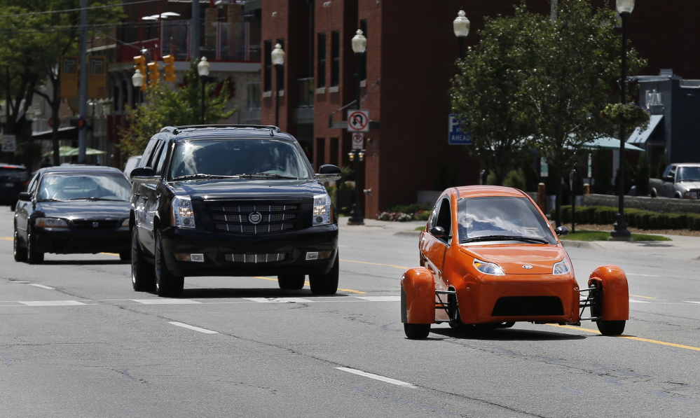 The Associated Press Instead of spending $20,000 on a new car, Paul Elio is offering commuters a cheaper option to drive to work. His three-wheeled vehicle The Elio will sell for $6,800 car and can save on gas with fuel economy of 84 mpg.