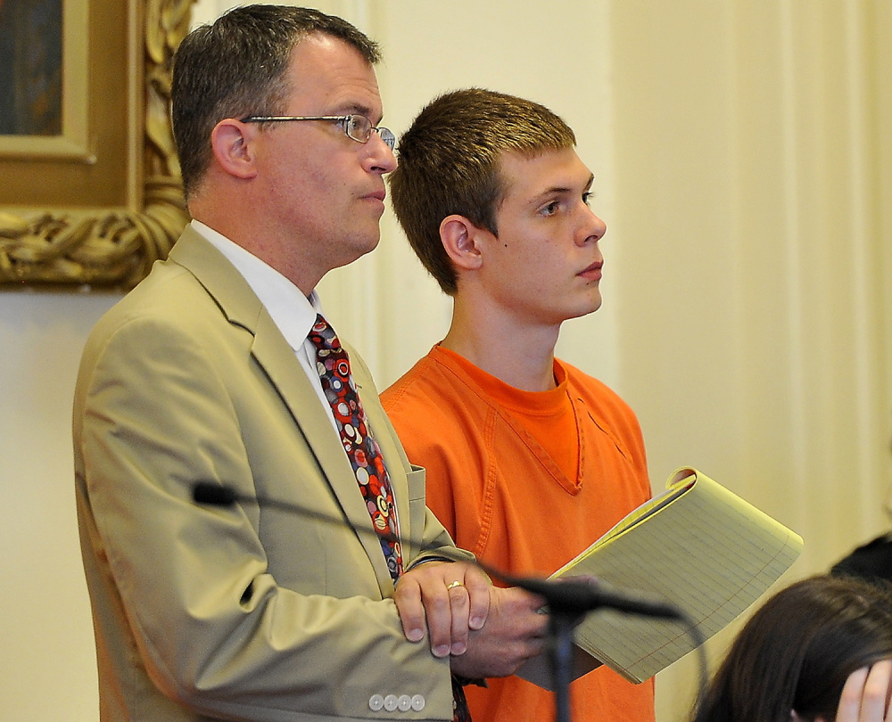 Anthony Carpinelli, shown at his arraignment in York County Superior Court, was sentenced to more than three years in prison for assaulting his infant sons.