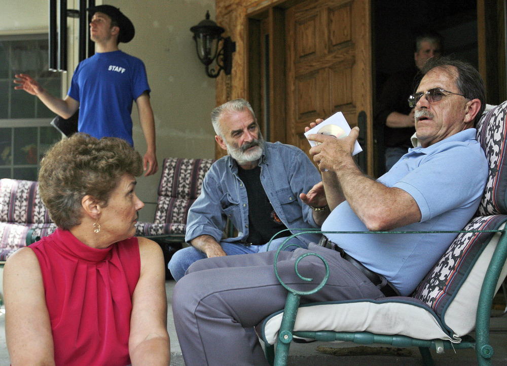 Ed Brown, right, and his wife Elaine Brown listen to Ruby Ridge, Idaho, survivor Randy Weaver, center, at their home in in Plainfield, N.H.