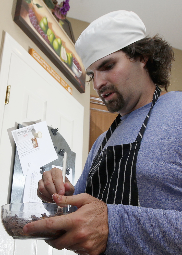 Matt Cottle, owner of Stuttering King Bakery, works in his parents' kitchen in Scottsdale, Ariz.