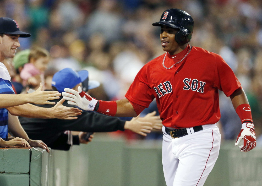 Red Sox outfielder Yoenis Cespedes celebrates his two-run home run in the fourth inning of Friday night's game against the Houston Astros in Boston.
