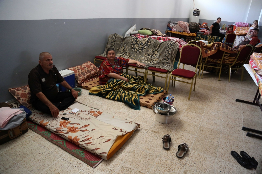 Displaced Iraqi Christians and Yazidis settle at diocese of Zakho, 300 miles northwest of Baghdad, Iraq, Saturday.