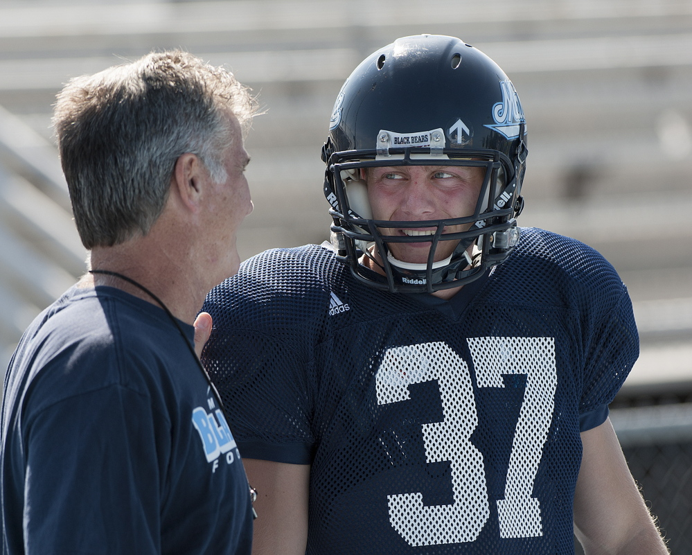 University of Maine Coach Jack Cosgrove, left, will count heavily on kicker Sean Decloux this season as the Black Bears' young offense matures.