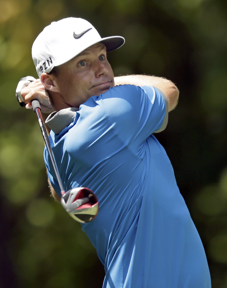 Nick Watney watches his tee shot on the second hole during the third round of the Wyndham Championship golf tournament in Greensboro, N.C., Saturday. The Associated Press