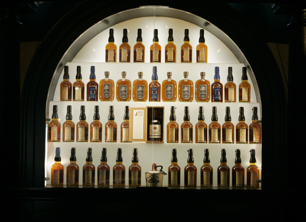 Bottles of bourbon are on display in a case at the Heaven Hill Bourbon Heritage Center in Bardstown, Ky. Kentucky bourbon makers have stashed away their largest stockpiles in more than a generation due to resurgent demand.