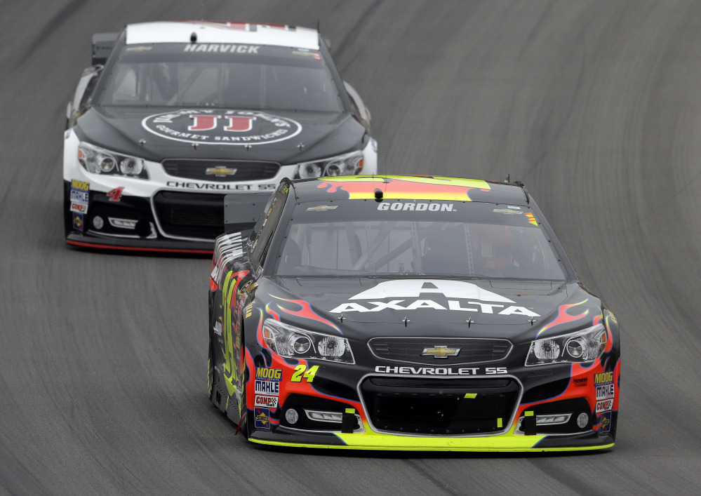 Jeff Gordon (24) races Kevin Harvick in the NASCAR Sprint Cup Series Pure Michigan 400 auto race at Michigan International Speedway in Brooklyn, Mich., on Sunday.