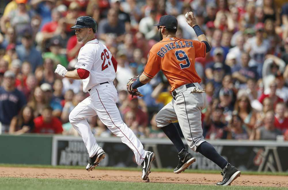 Houston Astros' Marwin Gonzalez (9) pursues Boston Red Sox's Daniel Nava in a rundown at second base after he tried to stretch a double during the third inning of a baseball game in Boston, Sunday.