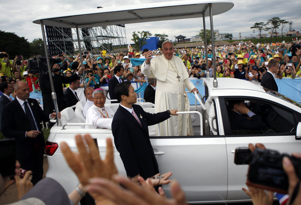 Pope Francis waves as he arrives for a closing Holy Mass of the 6th Asian Youth Day at Haemi Castle in Haemi, South Korea, on Sunday. He also urged the region's bishops to engage with people empathetically.