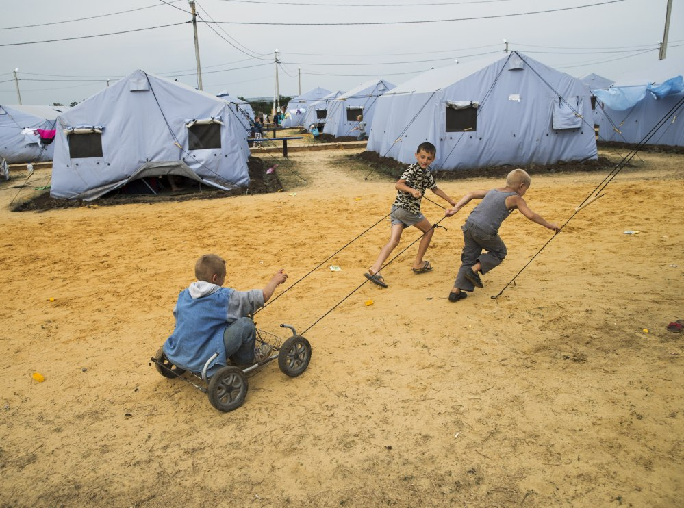 Several boys play Monday in a refugee camp near the border set up by the Russian Emergencies Ministry for people displaced by the fighting in Ukraine.