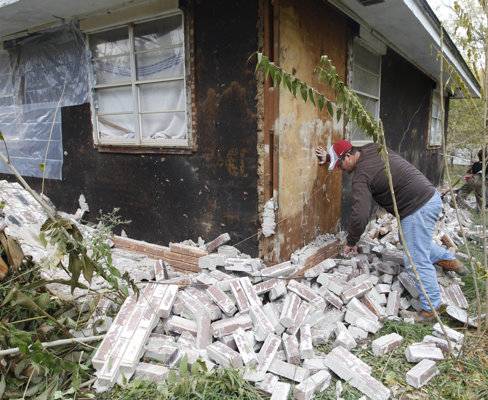Damage in Sparks, Okla., in 2011 was widespread after two earthquakes struck in less than 24 hours. Man-made quakes are weaker than natural quakes of the same magnitude.