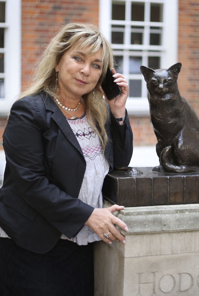 Hodge the Cat has words of wisdom for British comedian Helen Lederer at Tuesday's launch of Talking Statues in central London.