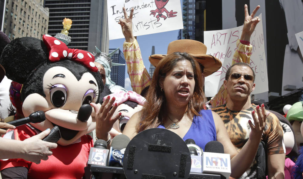 Costumed characters and their supporters gather Tuesday in Times Square.