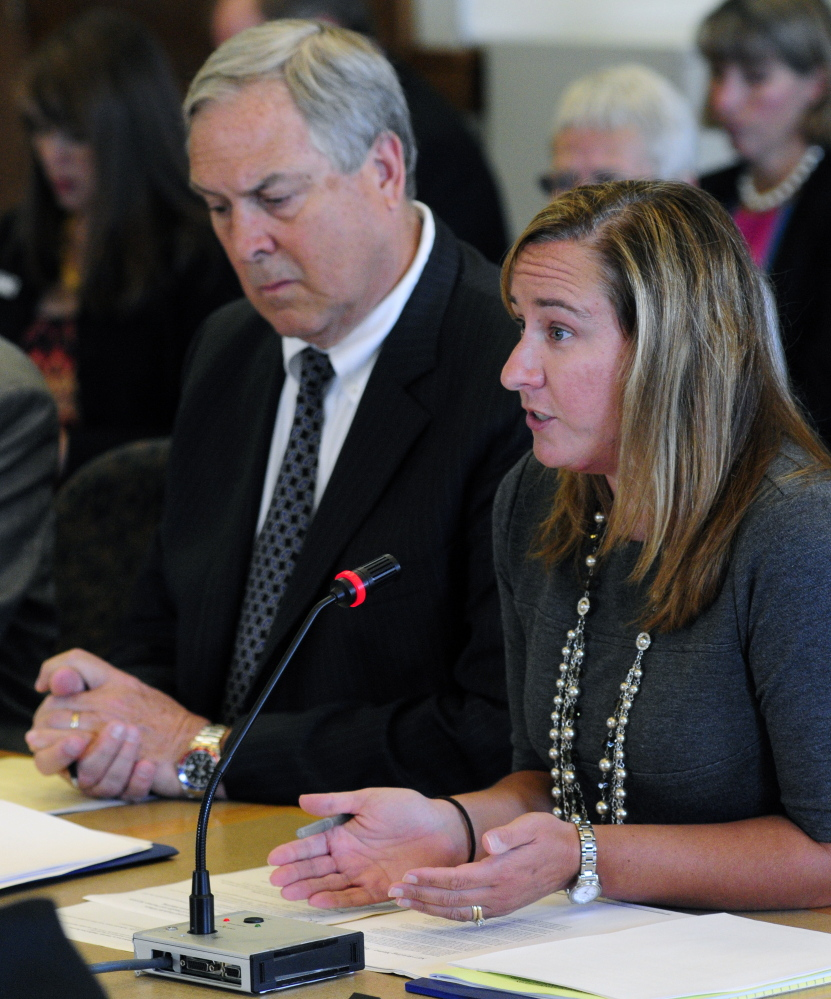 Ricker Hamilton, deputy commissioner for programs, left, listens as Stefanie Nadeau, director of MaineCare Services, answers questions Tuesday during a meeting of the Appropriations and Financial Affairs Committee with the Health and Human Services Committee in the State House in Augusta.