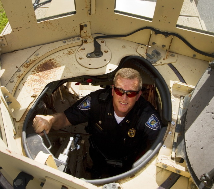 Sanford Police Chief Thomas Connolly on Tuesday looks out the hatch of the department's mine-resistant vehicle, obtained through a federal procurement program.
