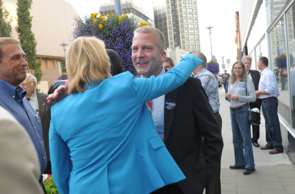 Republican U.S. Senate candidate Dan Sullivan receives a hug from a supporter in downtown Anchorage.