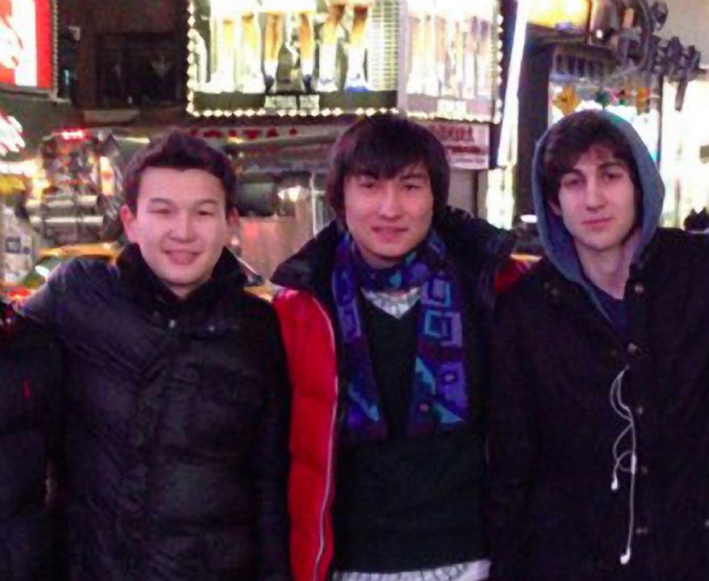 In this file photo, Azamat Tazhayakov, from left, Dias Kadyrbayev and Dzhokhar Tsarnaev pose at Times Square in a framegrab from Tsarnaev's page on VKontakt, the Russian equivalent of Facebook. Tazhayakov and Kadyrbayev are accused of removing evidence from Tsarnaev's dorm room after the marathon bombing.