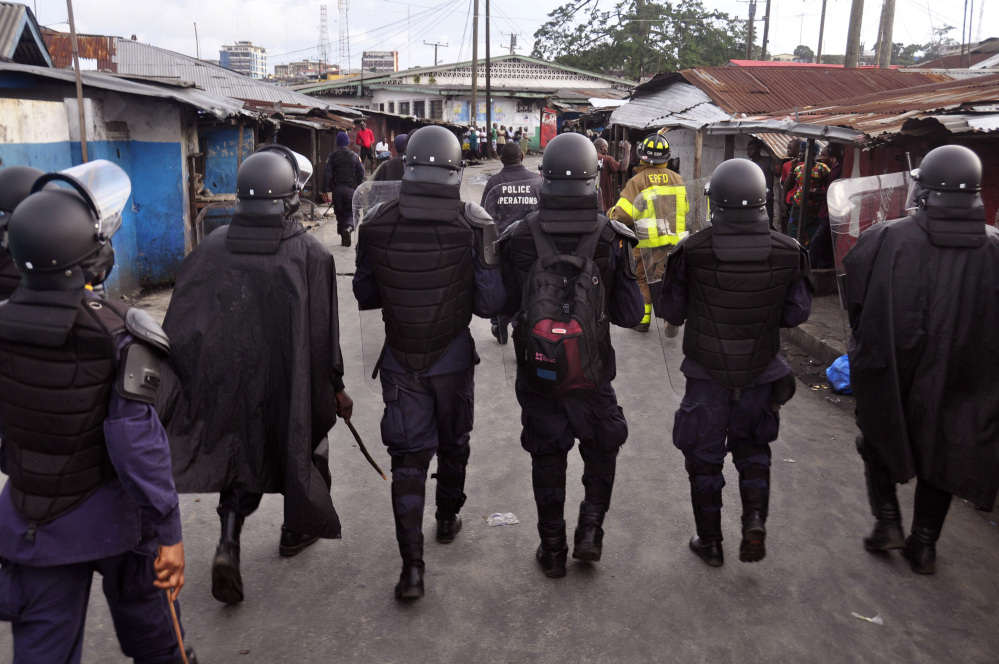 Liberia security forces patrol in the West Point slum. The Associated Press