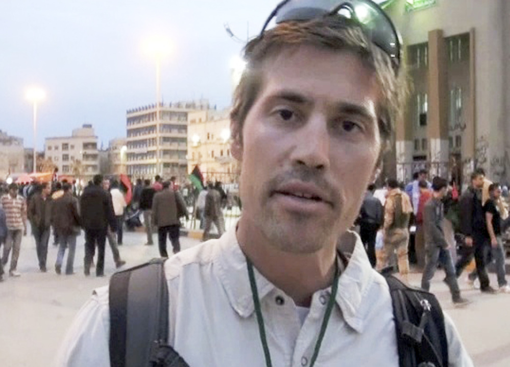 Photojournalist James Foley of Rochester, N.H., is shown in Benghazi, Libya, in 2011. He was executed by Islamic militants in a horrifying act of revenge for U.S. airstrikes in northern Iraq.