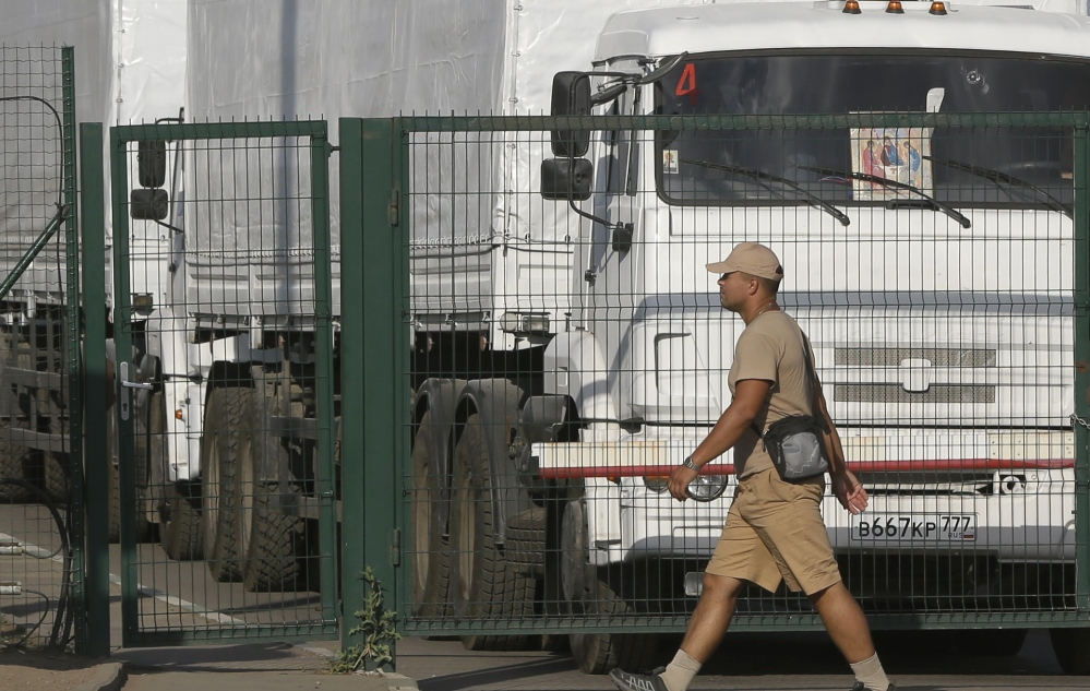 First trucks of the Russian aid convoy stand in the Russian inspection zone in the town of Donetsk.