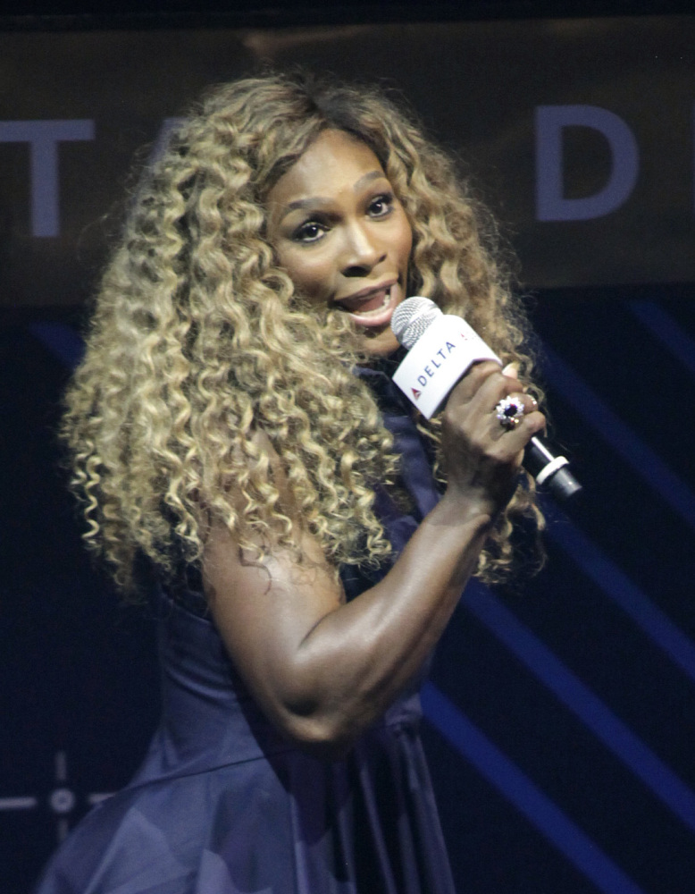 Tennis player Serena Williams performs karaoke on stage in New York.