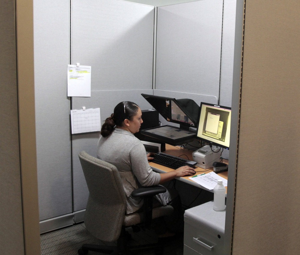 Evonne, a teller at Visterra Credit Union in Moreno Valley, Calif., speaks to a customer via video chat. The credit union has ATMs in its drive-through that allow customers to video chat with a teller.