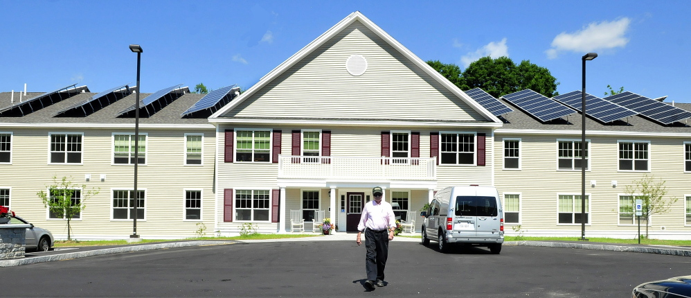 FARMINGTON,ME.-JULY 8: Brookside Village resident Alan Sawyer Sr. walks to his vehicle parked in front of the energy efficient senior housing facility in Farmington on Tuesday, July 8, 2014. (Photo by David Leaming/Staff Photographer)