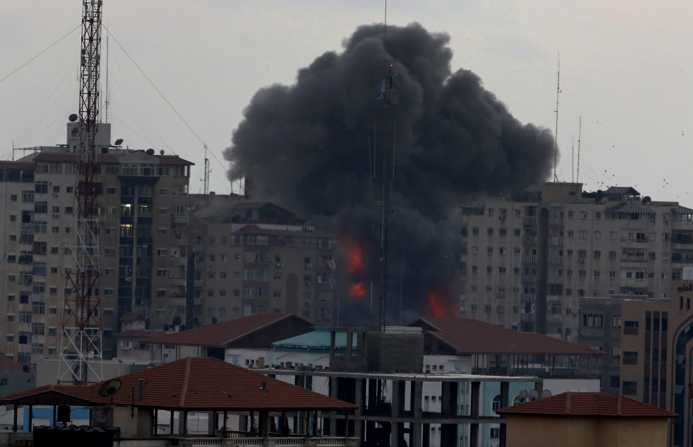 Smoke rises from an apartment tower in Gaza City on Saturday after an Israeli airstrike that displaced 44 families.