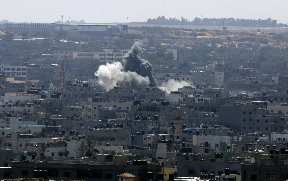 Smoke and dust rise after an Israeli strike hits in Gaza City, northern Gaza Strip, Tuesday.