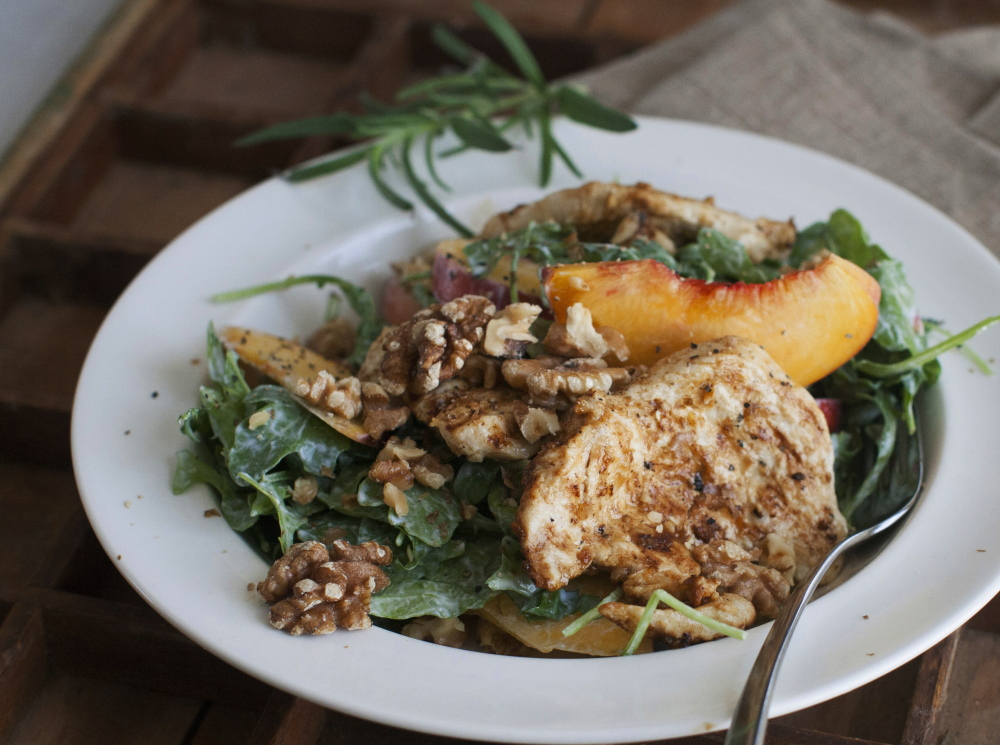 A grilled chicken paillard with peach and arugula salad is a light but filling choice for Labor Day parties.