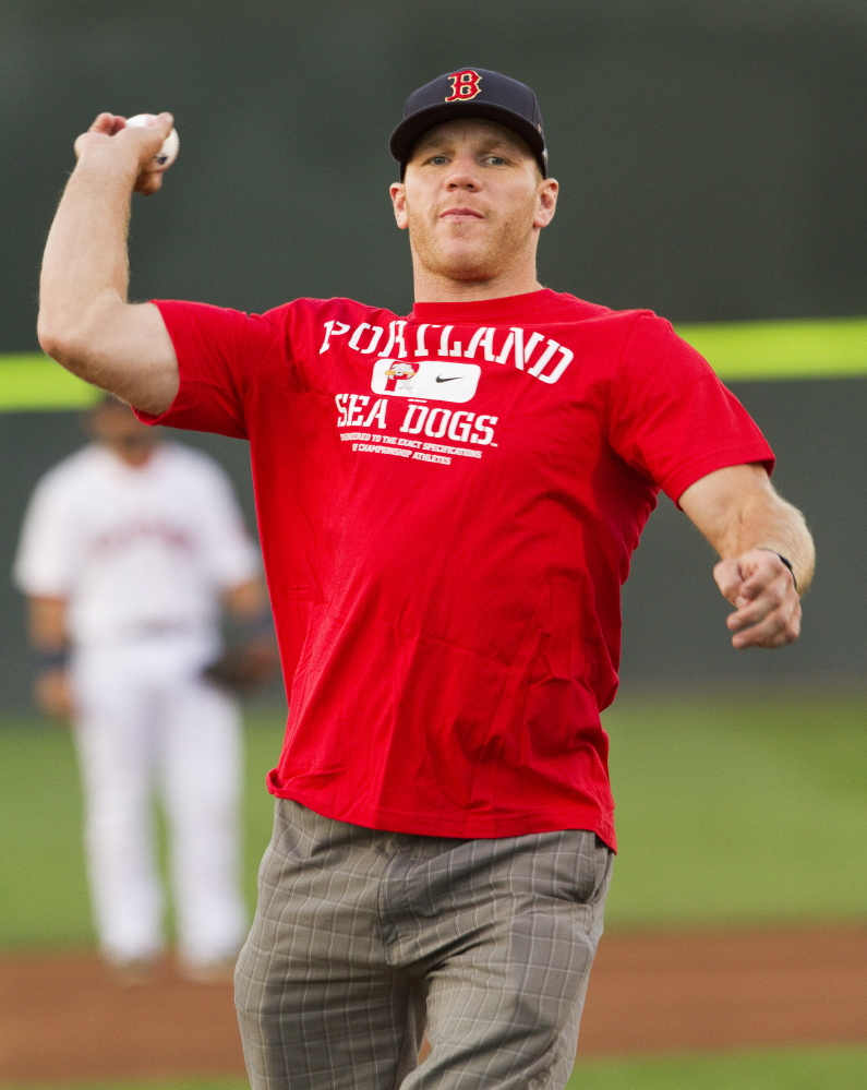 Boston Bruins left wing Shawn Thornton throws out the first pitch before the Portland Sea Dogs play the Reading Fightin Phils at Hadlock Field on Tuesday. Carl D. Walsh/Staff Photographer