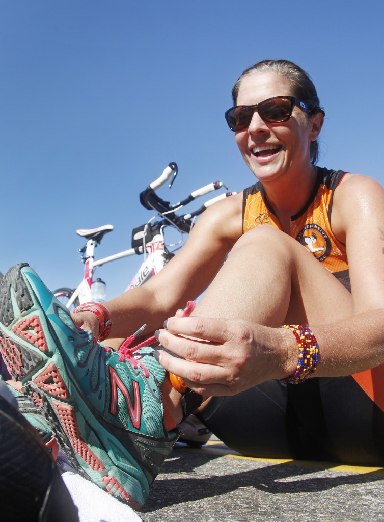 Kristine Cherbonneau of Derry, N.H., laces up for the 6.2 mile run portion of the Rev3 Triathlon.