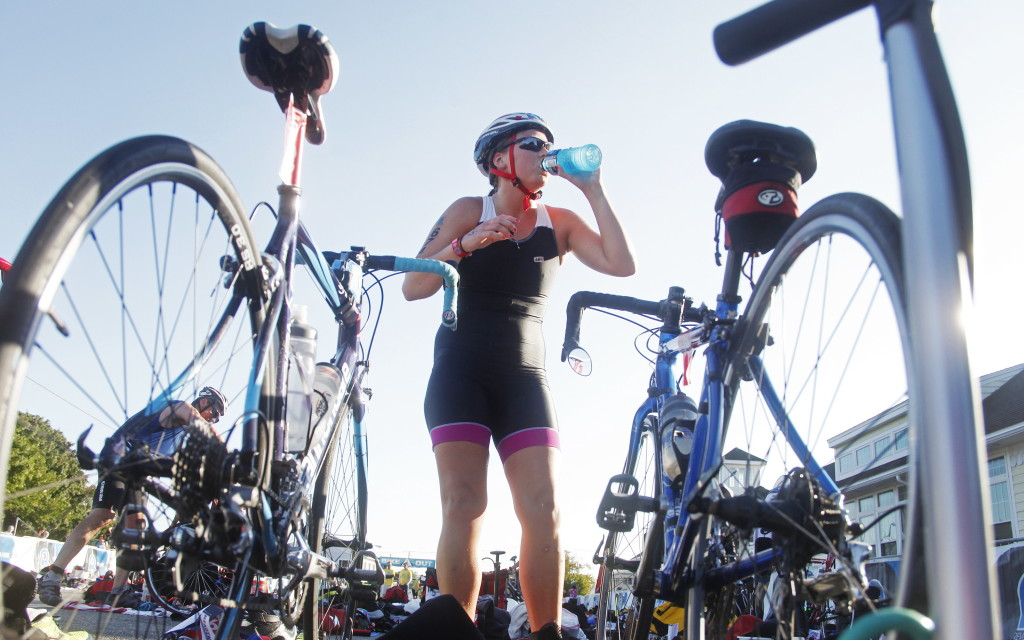 Sophie Flanagan of New Brunswick hydrates before hopping on her bike for the bicycle leg of the Olympic distance race. Competitors in the Olympic distance completed a 1.5-kilometer swim, a 40K bike ride and a 10K run.