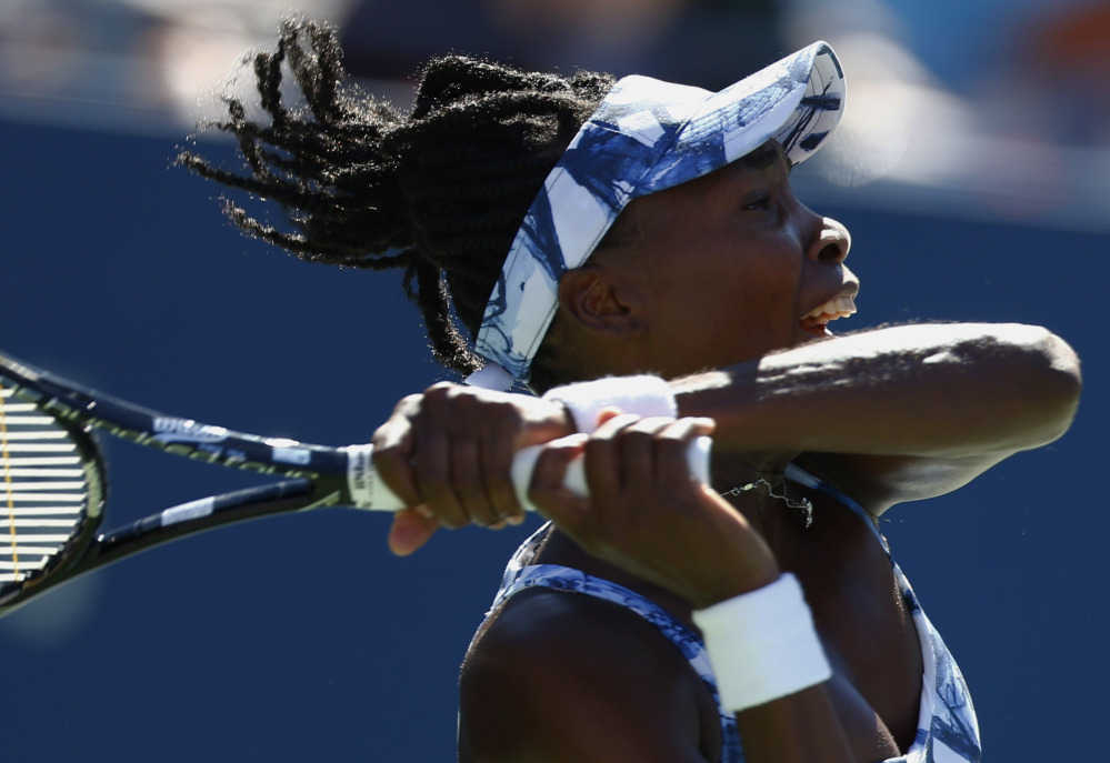 Venus Williams follows through on a shot against Sara Errani on Friday during the third round of the U.S. Open in New York. Williams was eliminated in three sets.